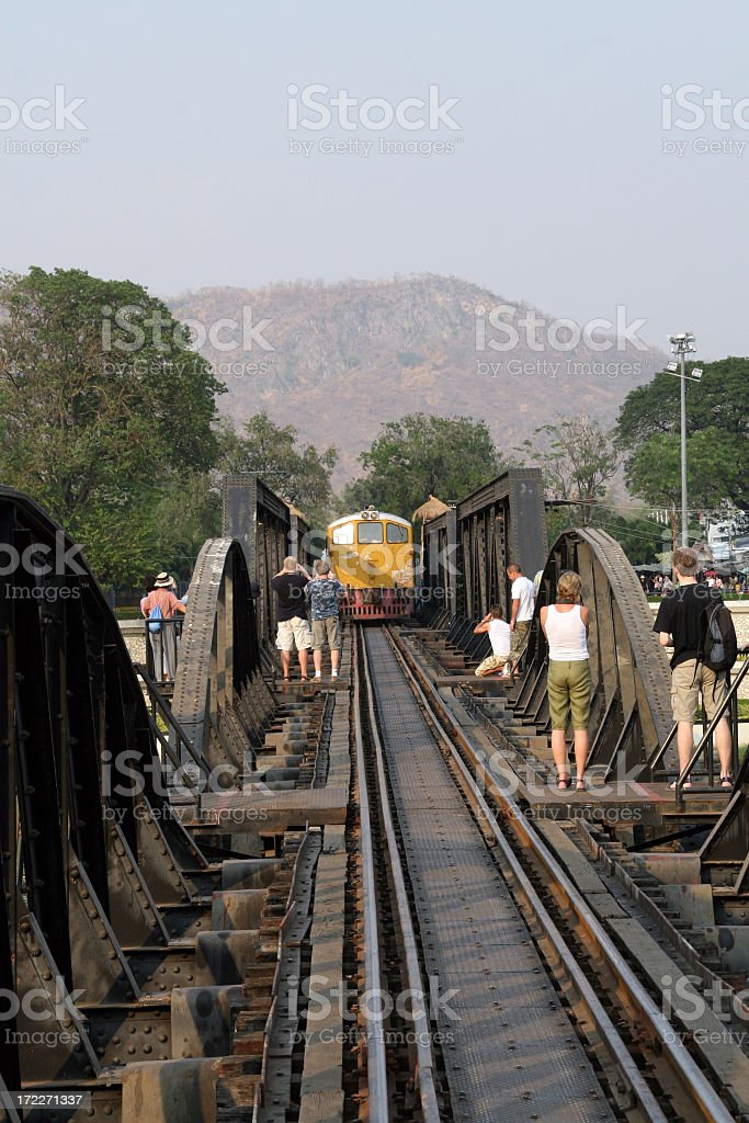 People on River Kwai Bridge, Thailand royalty-free stock photo