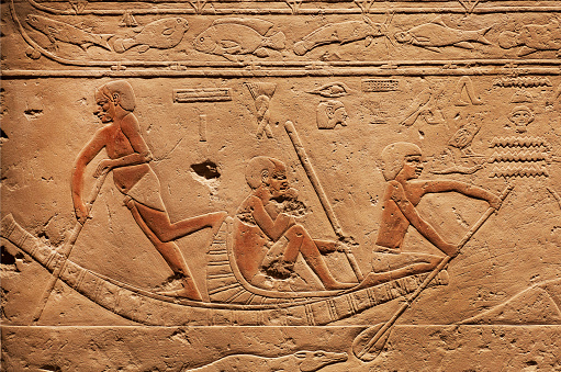 People on riverboat, relief on ancient Tomb of Sakkara, made at 2300 BC in Egypt