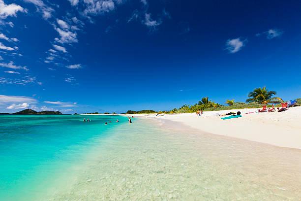 People on Sandy Island, Grenada stock photo