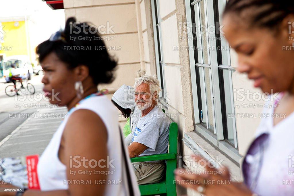People on sidewalk in Nassau, Bahamas royalty-free stock photo
