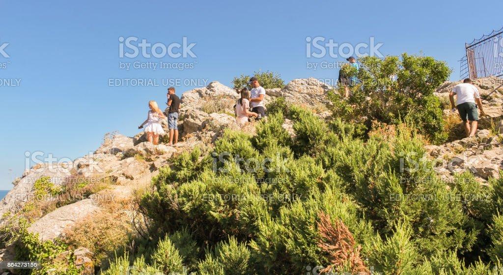 People on slippery rocks. royalty-free stock photo