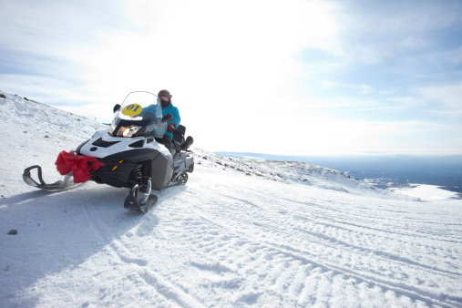 People On Snowmobile In Winter Mountain Stock Photo - Download Image Now