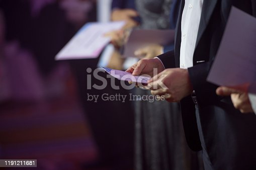 932724052 istock photo People on stage receiving awards 1191211681