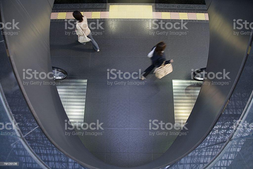 People on station platform stock photo