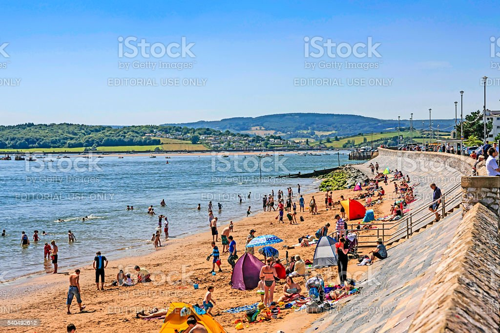 People on the beach at Exmouth, UK stock photo