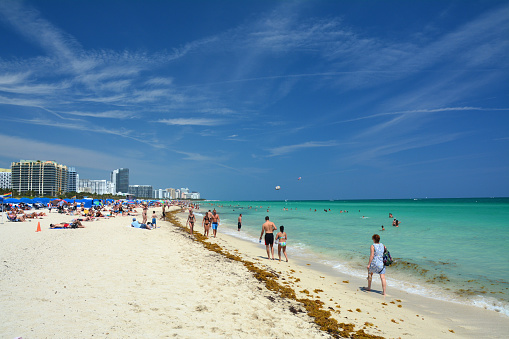 People On The Beach In Miami Beach Stock Photo - Download Image Now
