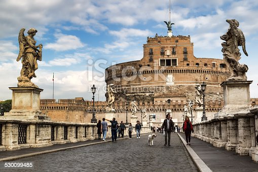 Rome, Italy - October 29, 2014: People on the bridge of Castel Sant'Angelo in Rome, Italy. The Mausoleum of Hadrian, usually known as Castel Sant'Angelo (English: Castle of the Holy Angel), is a towering cylindrical building in Parco Adriano, Rome, Italy.
