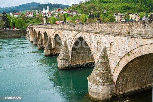 Visegrad, Bosnia and Herzegovinania. - April 29, 2019:  People on The Bridge on the river Drina in Visegrad is famous bridge fron Nobel prize viner novel ( Na Drini čuprija) by Ivo Andric.