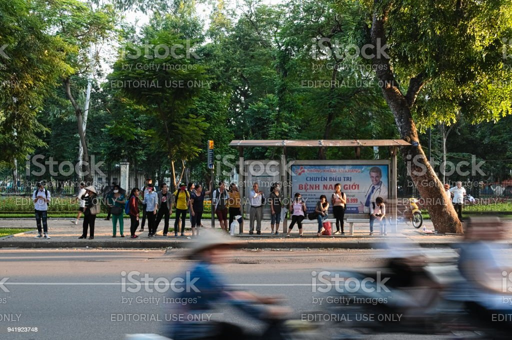 People on the bus stop in Hanoi stock photo