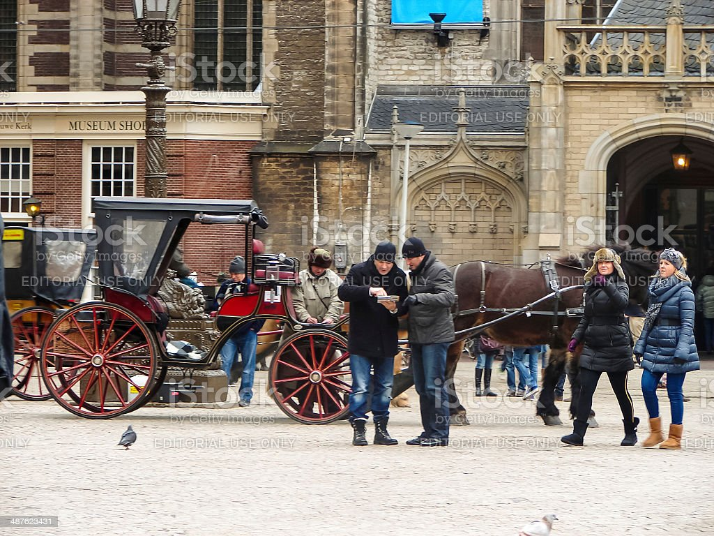 People on the Dam Square in   Amsterdam  . Netherlands stock photo