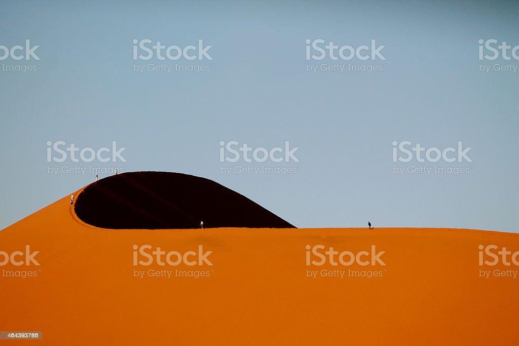 People on the dunes stock photo