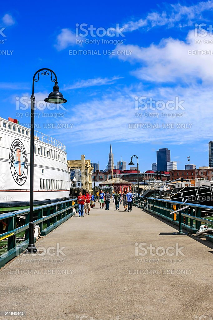 People on the Hyde Street Pier in San Francisco CA stock photo