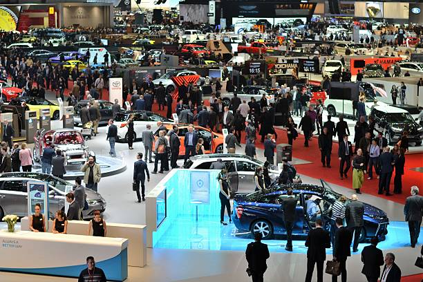 People on the motor show Switzerland, Geneva - March 1, 2016: The visitors (especially journalists and businessmens) looking on the new cars on the motor show. In a few days above 700 000 visitors from 110 countries saw the 900 vehicles from 220 brands on the Geneva Motor Show. car show stock pictures, royalty-free photos & images