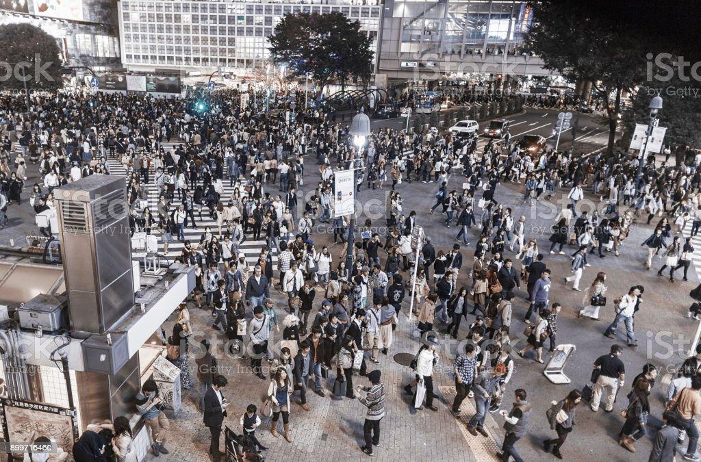 People on the move at Shibuya crossing Tokyo Japan stock photo
