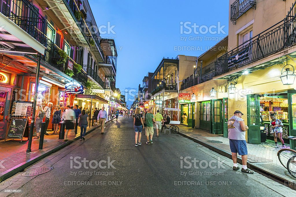 People on the move in Bourbon street at night - Stock image .
