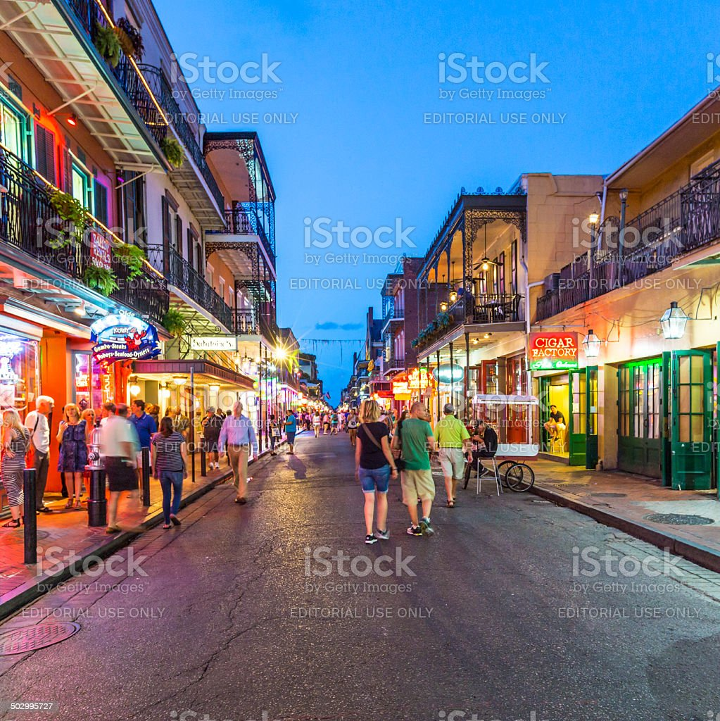 people on the move in the Burbon street at night stock photo