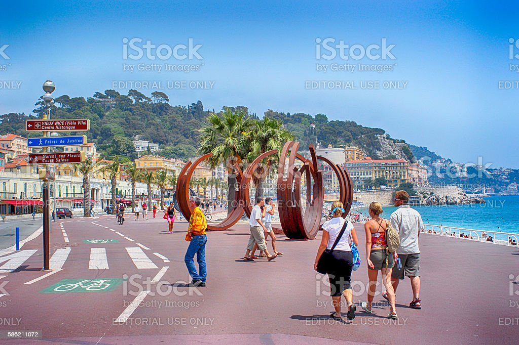 People on the promenade des Anglais in Nice, France stock photo