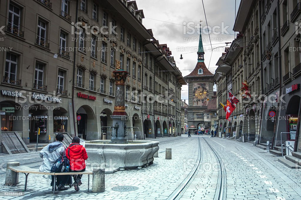 People on the shopping alley Kramgasse in Bern stock photo