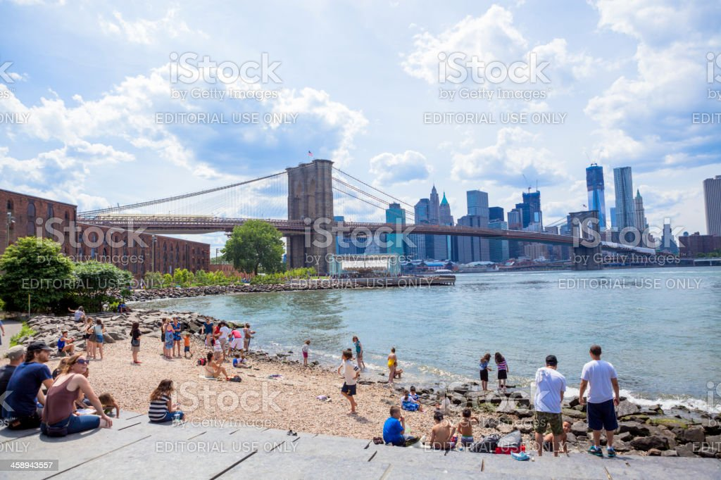 People on the Shore Brooklyn Bridge Park stock photo