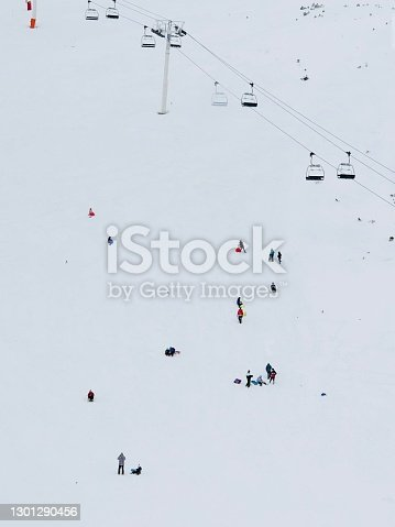 istock People on the snow 1301290456