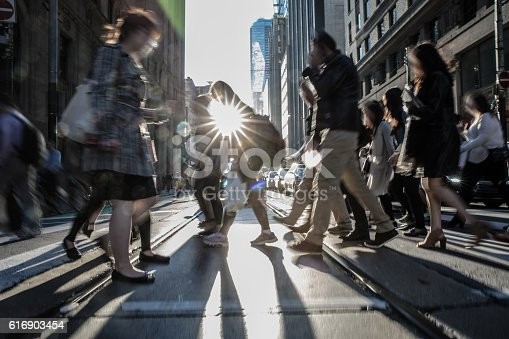 istock People on the street crossing in Toronto, Canada 616903454