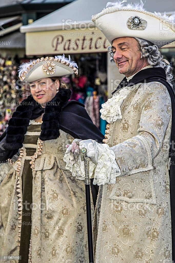 People on the street in Venice, dressed in period costumes stock photo