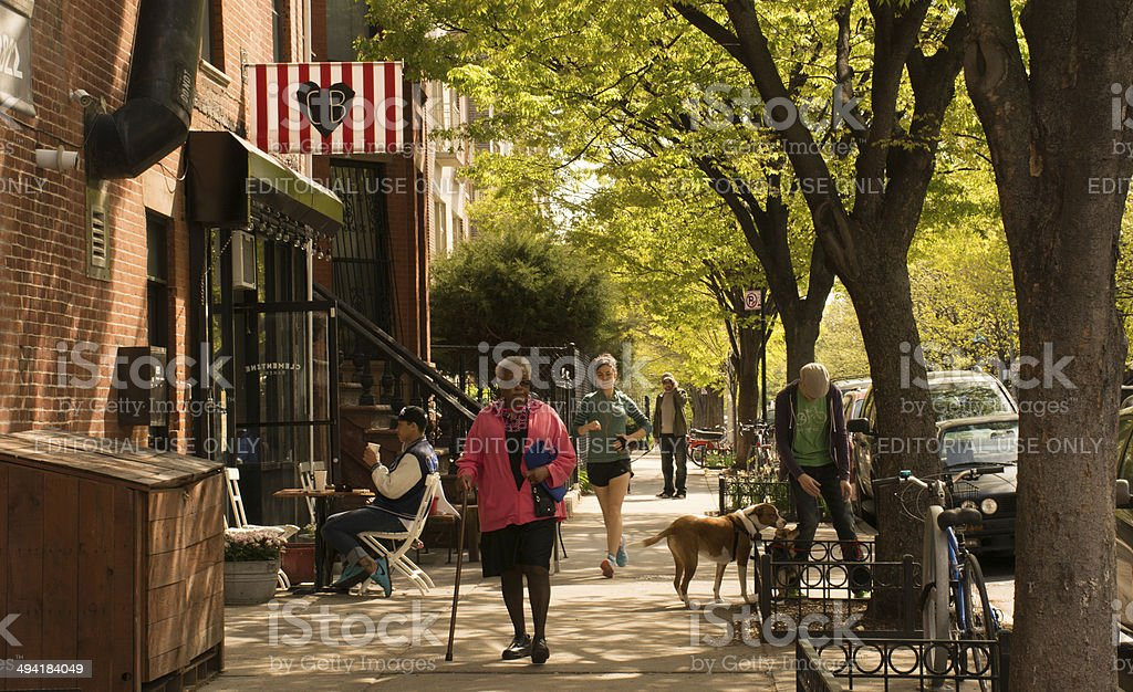 People on the street on a weekend morning in Brooklyn stock photo