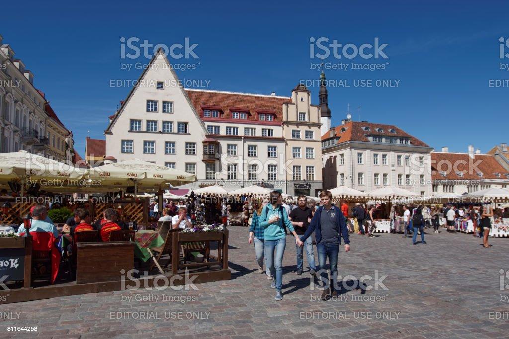 People on the Town Hall square in Tallinn, Estonia stock photo