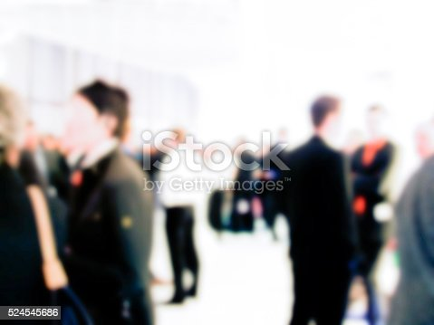 istock people on trade fair convention - blurred 524545686