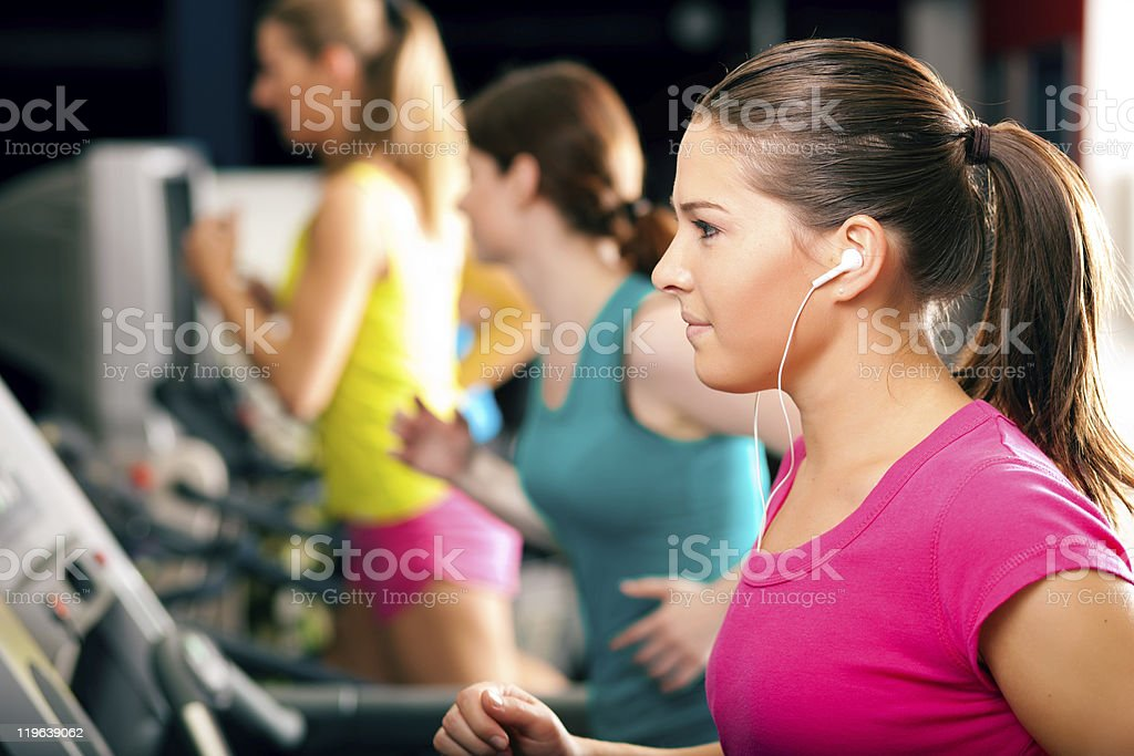 People on treadmill in gym running stock photo