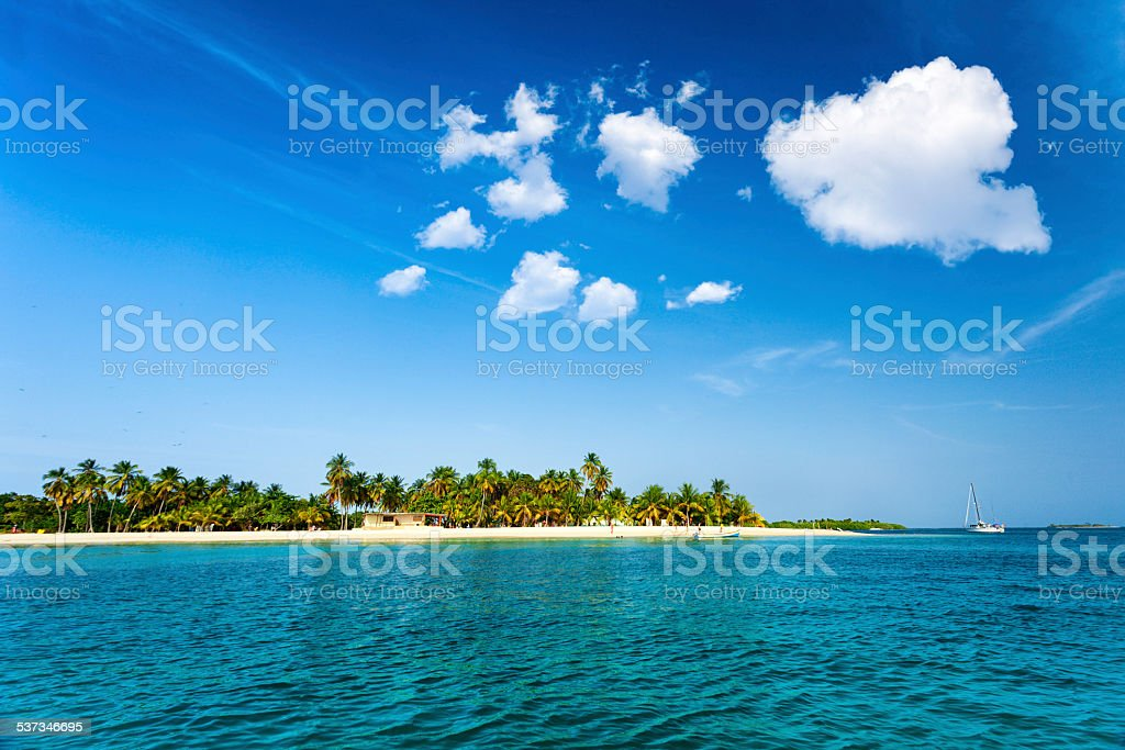 People on tropical island beach in the Caribbean stock photo
