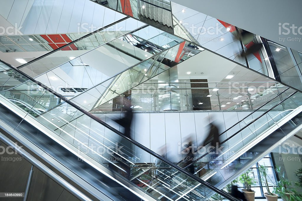 People on Two Crossed Escalators, Blurred Motion stock photo