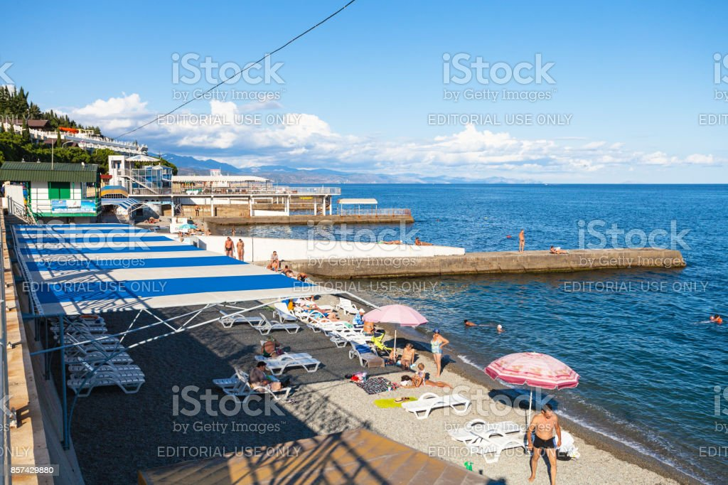 people on urban beach in Alushta city stock photo
