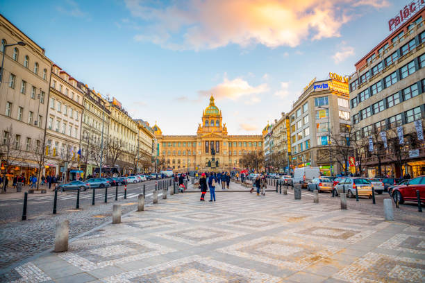 People on Wenceslas Square at sunset lights in Prague, Czech Republic. Prague, Czech Republic - January 12, 2019: People on Wenceslas Square at sunset lights in Prague in Czech Republic. wenceslas square stock pictures, royalty-free photos & images