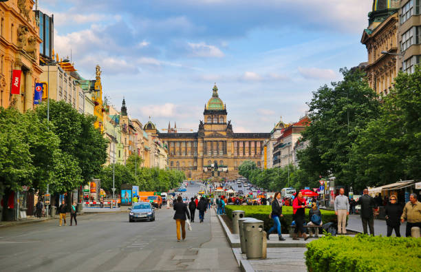 People on Wenceslas Square in Prague Prague, Czech Republic - August 9, 2017: People on Wenceslas Square in Prague on a summer afternoon, Czech Republic wenceslas square stock pictures, royalty-free photos & images