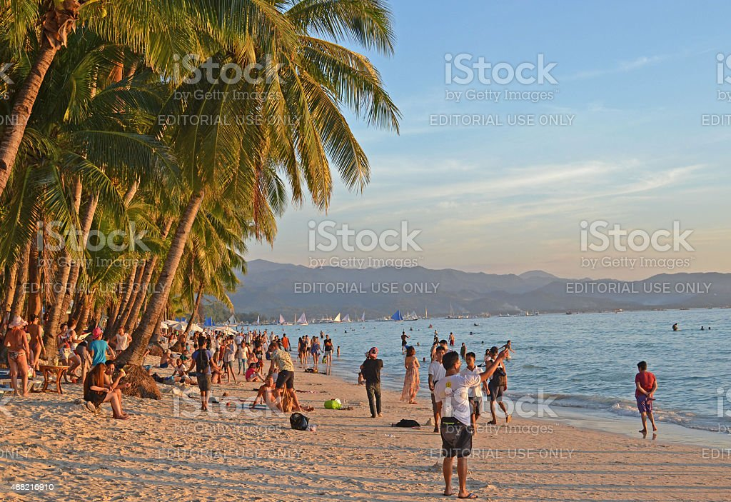 People on White Beach, Boracay. stock photo