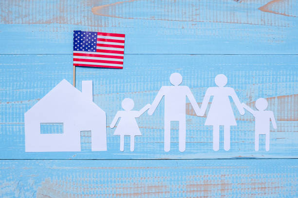people or family and home paper shape with  flag of the united states of america on blue wooden background. usa holiday of veterans, memorial, independence and labor day - family 4th of july zdjęcia i obrazy z banku zdjęć