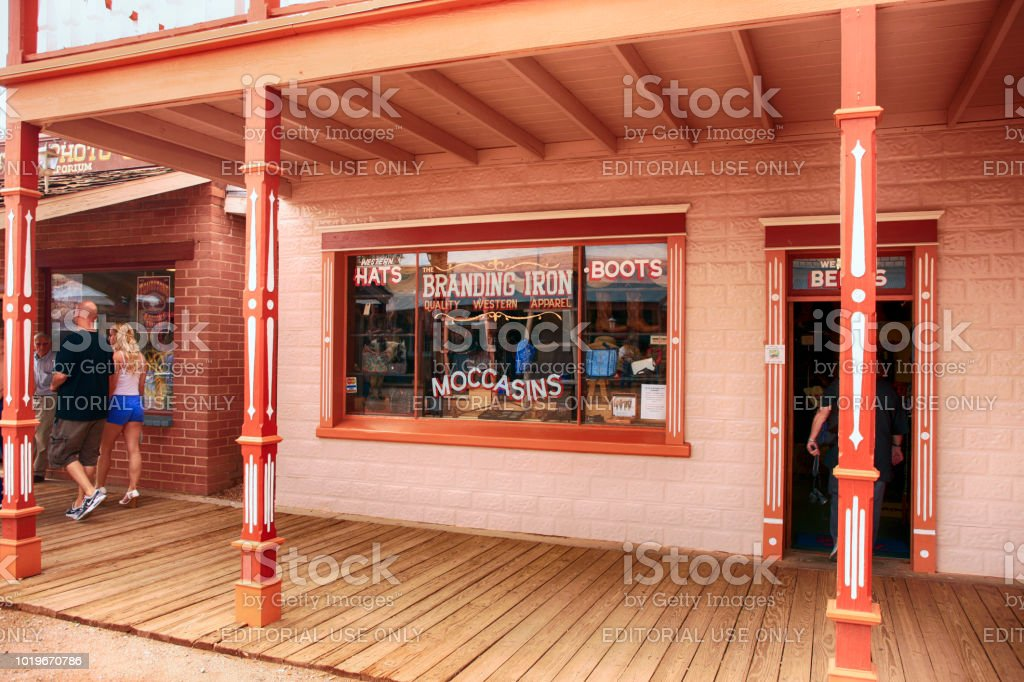 695b6964b25 People outside Branding Iron quality Western Apparel store on E Allen St in  historic Tombstone