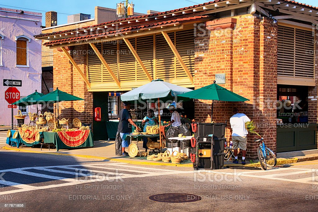 People outside the historic downtown City Market in Charleston, SC stock photo