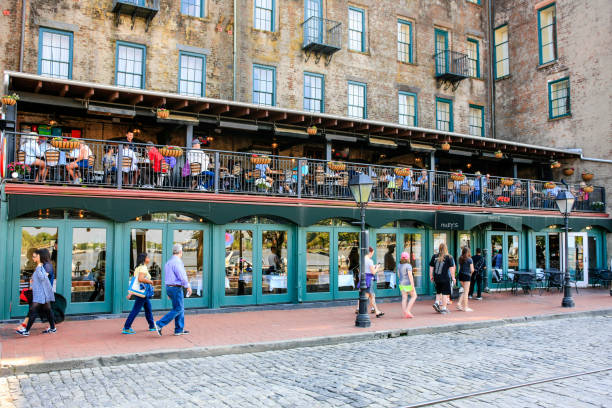 People outside the River Street Inn pub and hotel in downtown Savannah Georgia, USA stock photo