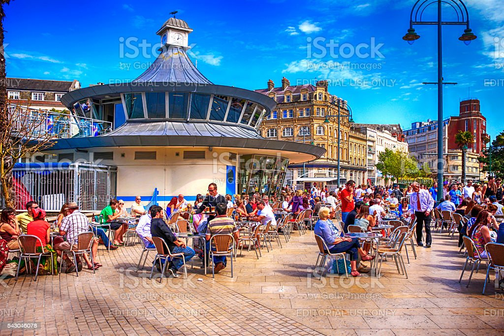 People outside the Round Cafe in Bournemouth, UK stock photo