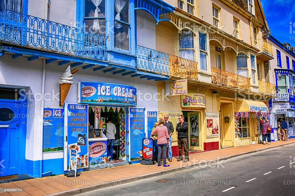 People outside Victorian frontage shops in Ilfracombe, UK stock photo