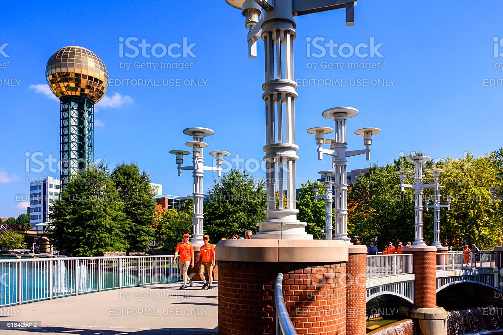 People overlooked by the Sunsphere in the 1982-World's-Fair-Park, Knoxville, TN stock photo