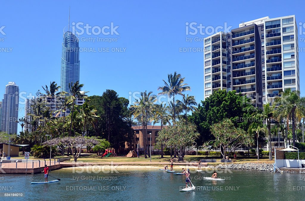 People paddle board in Gold Coast Queensland Australia stock photo
