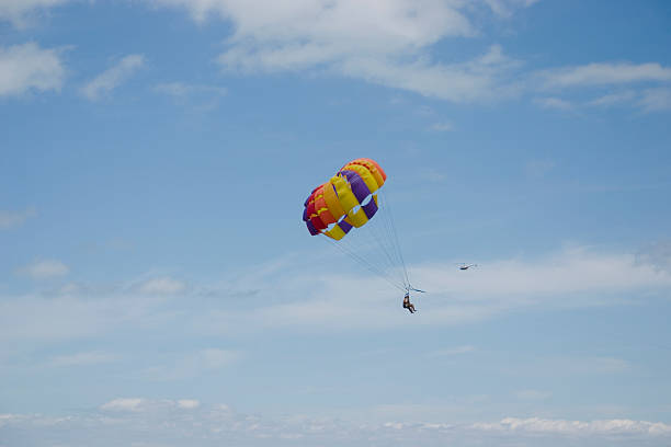 People Parasailing and a Helicopter stock photo