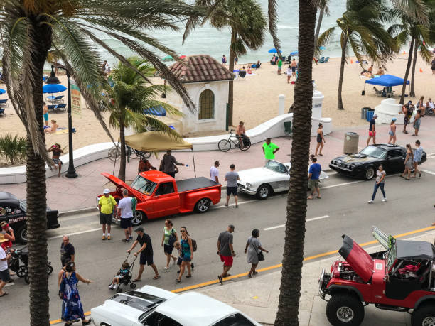 people participate in classic cars show at fort lauderdale beach - memorial day weekend стоковые фото и изображения