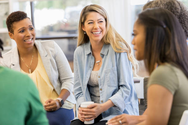 People participate in support group session stock photo