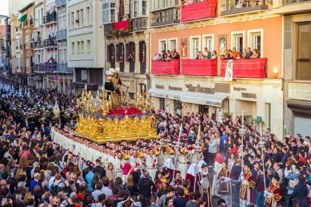 personer som deltar i processionen i den heliga veckan i en spansk stad - easter procession spain bildbanksfoton och bilder