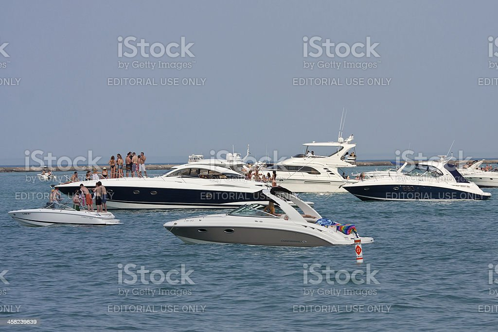People Party On Boats Anchored In Lake Michigan royalty-free stock photo