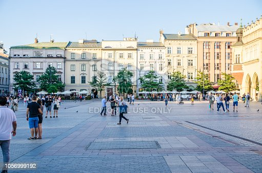 People passing by on Market Square in Krakow Poland during summer day
